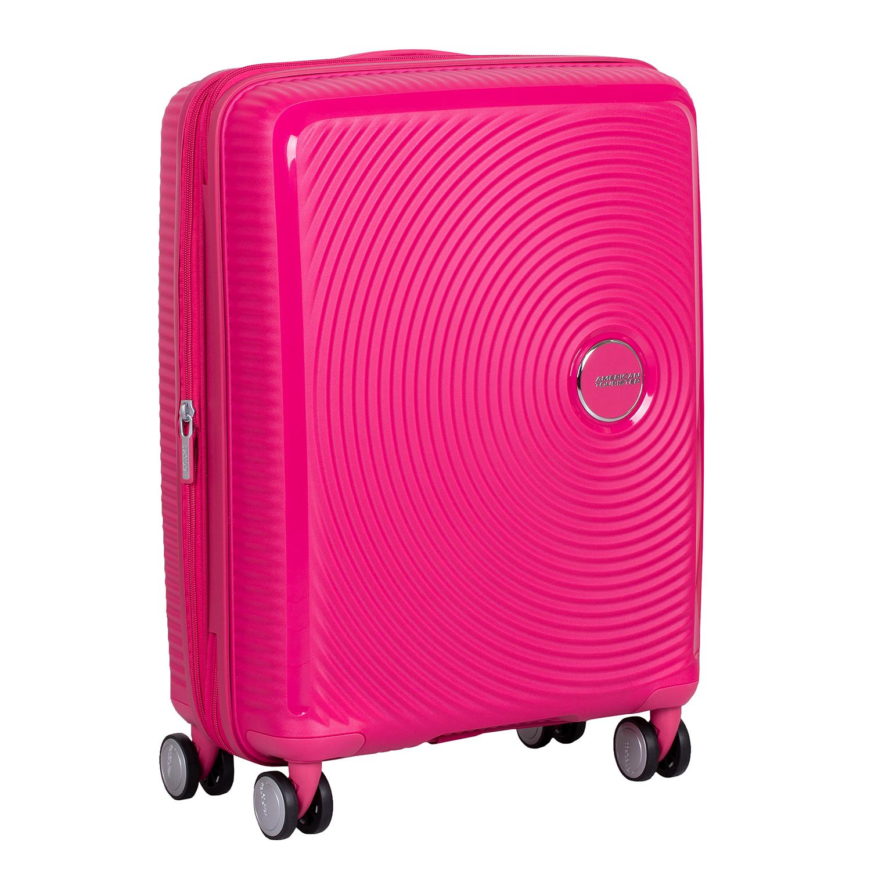 Růžový skořepinový kufr