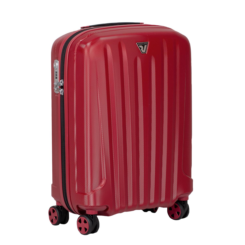 Malý červený škrupinkový kufor na kolieskach