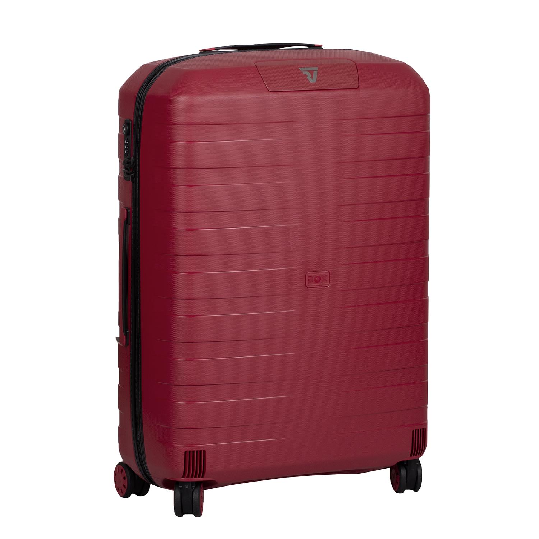 Veľký červený kufor na kolieskach